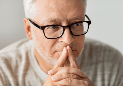 Older man considering dental implant tooth replacement options