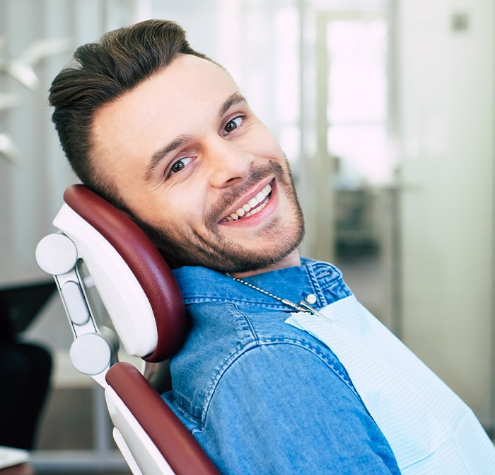 Man smiling after preventive dentistry appointment