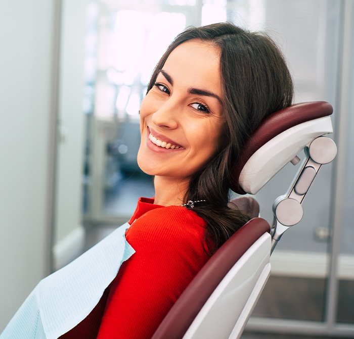 Woman smiling in high tech dental exam room