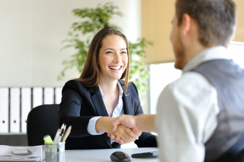 Woman smiling in job interview